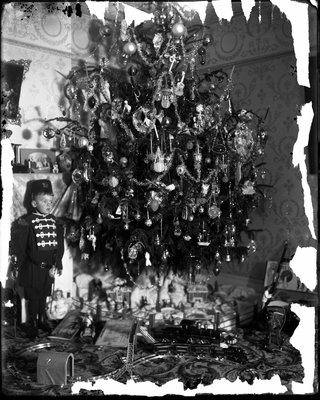 Realey, Charles, at Christmas tree, dressed as soldier